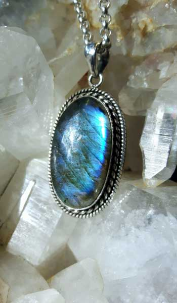 Oval black labradorite pendant on a sterling silver chain
